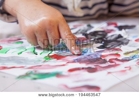 beautiful little baby girl draws a picture paints (postmodernism talent creativity creativity)