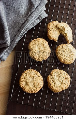 Gluten Free Homemade Oatmeal Cookies And Napkin On Cooling Rack. Vertical. Selective Focus