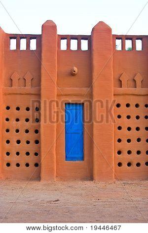 A blue wooden door in an African buliding