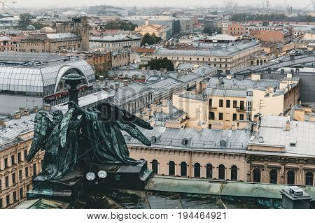 View from the roof, colonnade of St. Isaac's Cathedral in St. Petersburg on a cloudy rainy day, toned