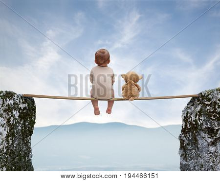 Little boy and plush teddy bear watching the beautiful landscape