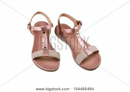 Pair of women's sandals isolated on white background.