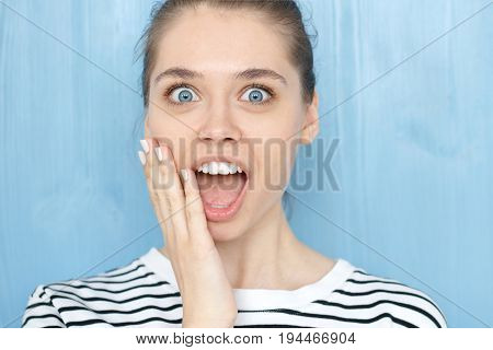 Portrait Of Astonished Young Caucasian Female Employee Or Customer Dressed Casually, Shouting With S