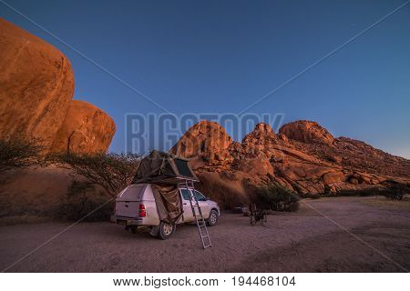 Spitzkoppe Namibia- 24 MAY 2017: Camping with a 4x4 car (Toyota Hilux) and roof top tent.