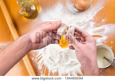 Man Spiting Yeast In Dough Making
