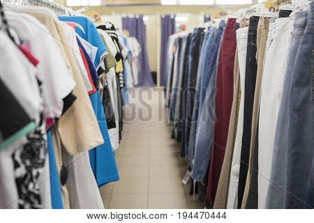 Men's T-Shirts & Jeans on the counter of the store