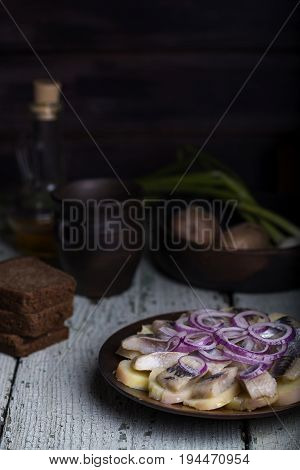 Salted Herring With Potatoes And Onions
