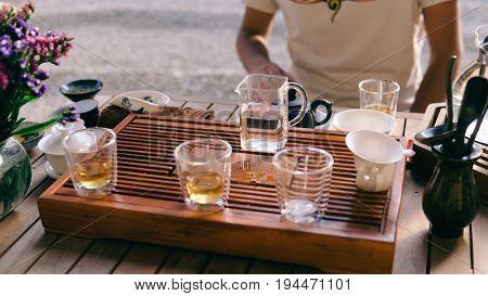 Pialas For Tea Ceremony Standing On A Shepherd Close-up. Dishes For The Tea Ceremony On The Tea-boar