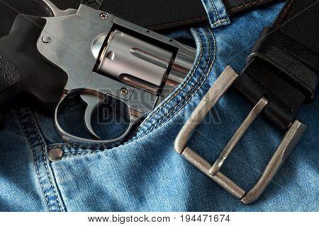 Chromed revolver jeans and belt close up