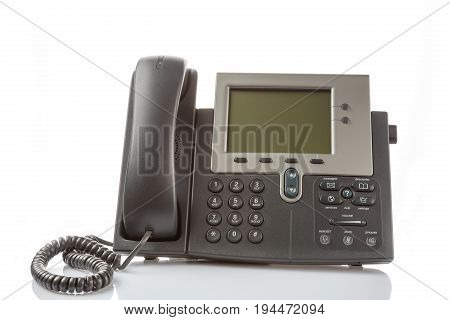 Modern IP digital phone isolated on white background with reflection. Enterprise IP voice solution concept.