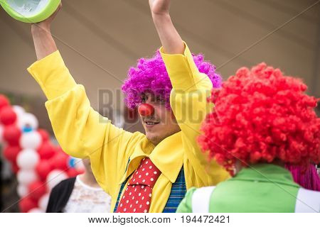 A happy clown performs his skills in a children's show