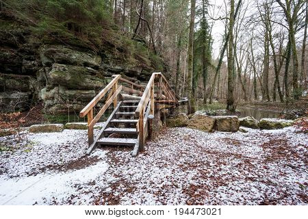 bridge in Luxembourg's Little Switzerland whit white snow