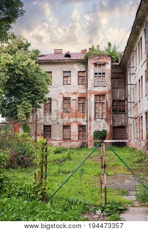 Abandoned jewish hospital with boarded up window in Kaunas, Lithuania built in 1836