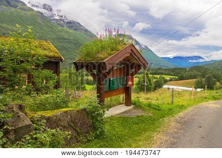 Norwegian mailboxes with grass roof in natural landscape