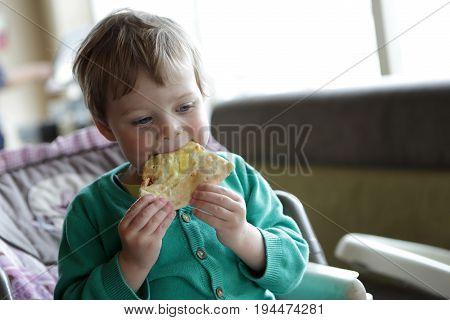 Child Eating Focaccia