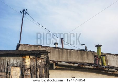 rooftops of poor sheds and buildings in slums