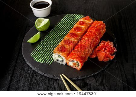 Philadelphia roll sushi with salmon, cucumber, cream cheese. Sushi menu. Japanese food. Original serving of dishes from the chef