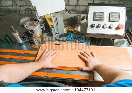 Carpenter works for Edge Banding Machine In workshop