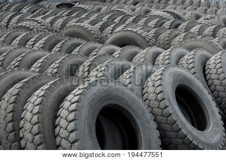 Warehouse of old used tires, outdoors, old wheels