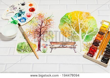 Hand Drawn Bright Sketch with autumn park with trees, bench, bush and lying flat paints, paintbrushes and palette on the white brick background - concept of human creativity, perspective view
