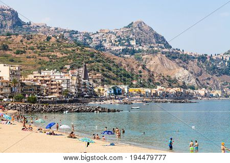 Tourists On Urban Beach In Giardini Naxos Town