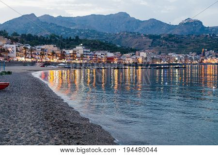 Beach In Giardini Naxos City In Summer Evening