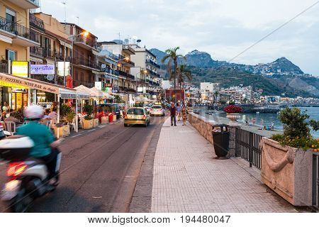 People, Shops On Waterfront In Giardini Naxos