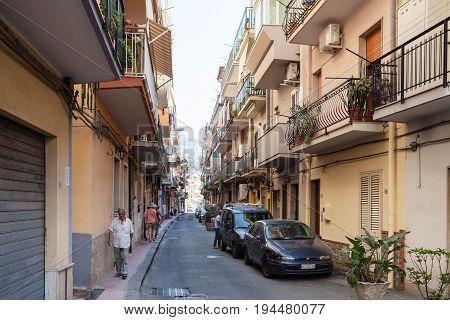 People On Street Via Naxos In Giardini Naxos Town