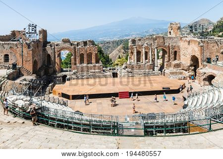 Teatro Antico And View Of Etna Mount In Taormina