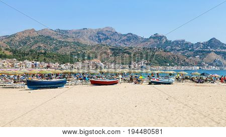 People And Boats On Beach In Giardini Naxos City