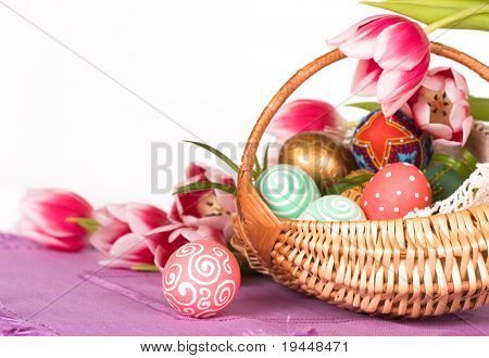 Basket full of Easter eggs  and tilips