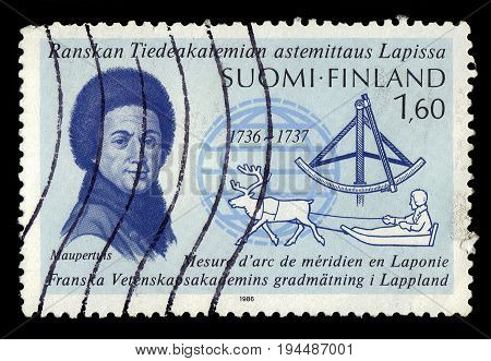 FINLAND - CIRCA 1986: a stamp printed in Finland shows portrait Pierre Louis Moreau de Maupertuis, french scientist, mathematician, philosopher, 250th ann. of the french survey expedition in Lapland, circa 1986