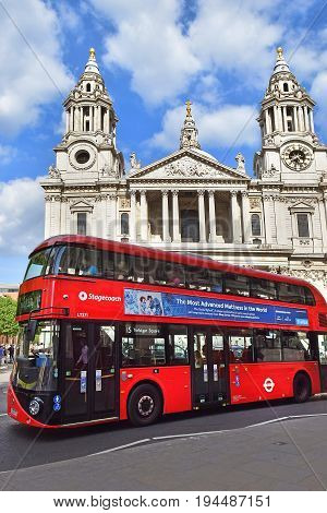 LONDON, ENGLAND - May 25,2017: famous red double-decker bus, one of the symbols of London on the background of the western facade of St. Paul Cathedral in London, UK