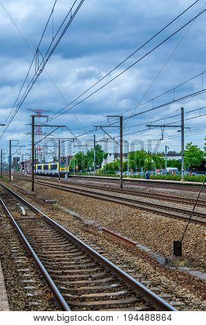 RUISBROEK, BELGIUM, JUNE 12, 2017: VEIWS FROM THE PASSENGER PLATFORM AT THE STATION IN RUISBROEK, BELGIUM ON JUNE 12, 2017