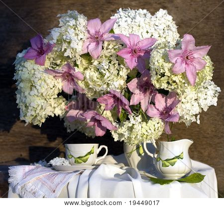 a bouquet of hydrangeas and clematis, tea