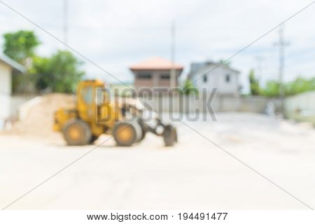 Absract Blur Background Yellow Hydraulic Tractor Loader Or Backhoe Working In Construction Site