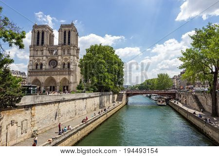 PARIS - JUNE 19 2015: View on the Notre Dame Cathedral along the Seine in the heart of Paris.