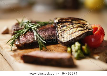 piece of rib eye steak with vegetables, shallow focus