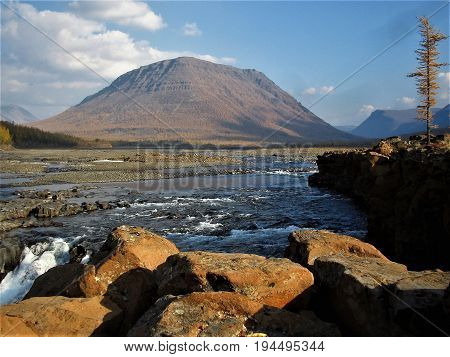 The Taimyr Peninsula. Putorana Plateau. The river flowing into the lake Glubokoe.