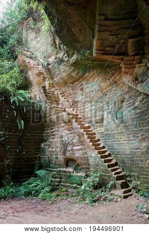 Stairs entrance or exit to the old historic limestone mine cave in Arosbaya madura indonesia