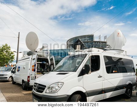 STRASBOURG FRANCE - JUN 30 2017: Mercedes Sprinter TV Media Television Trucks with multiple Satellite parabolic antennas and fiber optic cables preparing to report live the official European Ceremony of Honour for Dr. Helmut Kohl at European Parliament