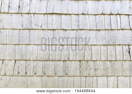 Ancient whit wooden wall made of small timber sheets