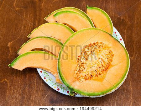 Slices Of Ripe Sicilian Cantaloupe Melon On Table