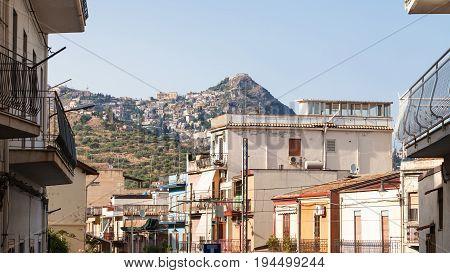 Houses In Giardini Naxos And View Of Taormina City