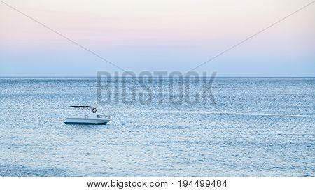 Boat In Sea In Blue Summer Evening