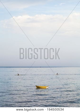 Boat And Canoes Near Waterfront In Giardini Naxos