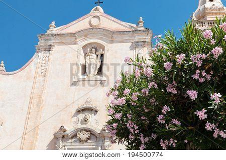 Flowers And Chiesa Di San Giuseppe In Taormina