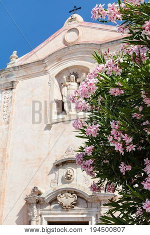 Flowers And Church San Giuseppe In Taormina City