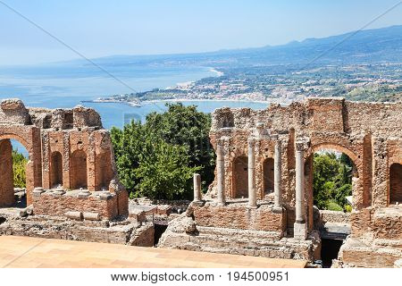 View Of Ruined Teatro Greco And Ionian Sea Coast
