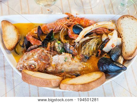 Fish Soup With Seafood In Sicilian Restaurant